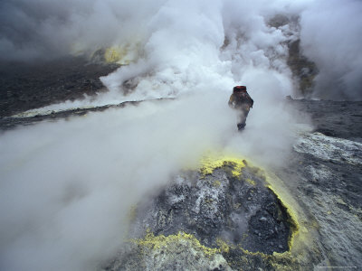 Volcanologist Probes Fumaroles on a Sulfur-Encrusted Crater Photographic Print by Peter Carsten