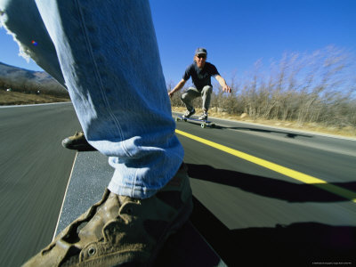 Jim Hall and Mark Youngquist Skateboard down a Paved Road Photographic Print by Bill Hatcher