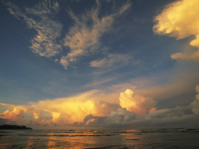 Clouds Glow in the Light of the Setting Sun Photographic Print by Steve Winter