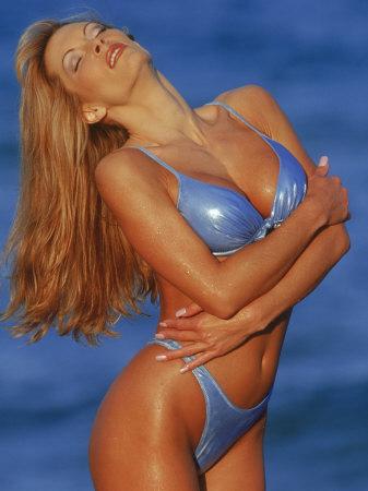 Woman in Bikini Posing on Beach Photographic Print by Bill Keefrey
