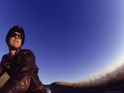 Man on Motorcycle Photographic Print by David Wasserman