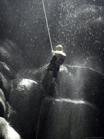 Climber Showered with Water in Cave, Mexico Photographic Print by Michael Brown