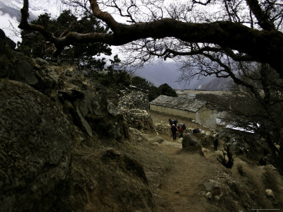Climbers Hiking Through Small Mountain Village, Nepal Photographic Print by David D'angelo