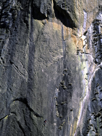Climber Perched on Large Rock Wall, Madagascar Photographic Print by Michael Brown
