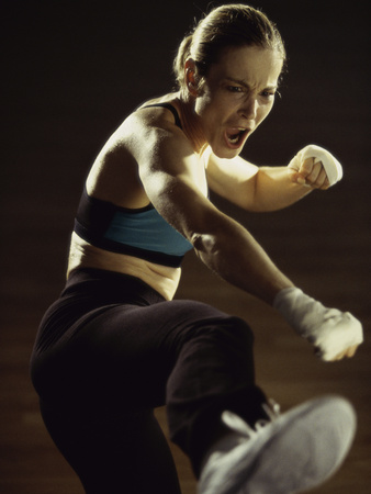 Young Woman Kickboxing Photographic Print