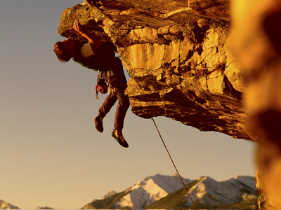 Mountain Climber Hanging from a Rock Photographic Print