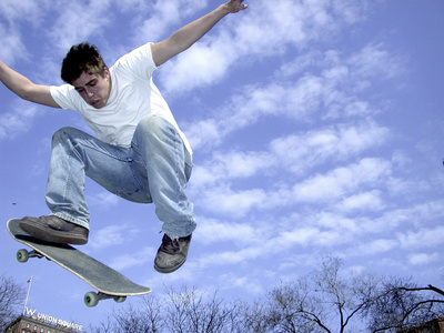 Skateboarder in Midair Photographic Print
