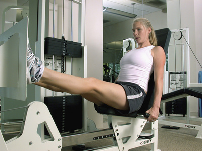 Woman Working Out on a Weight Machine Photographic Print