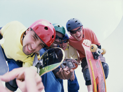 Low Angle View of a Group of Young Men Holding Skateboards Photographic Print