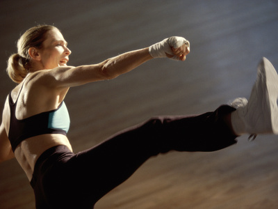 Side Profile of a Young Woman Kickboxing Photographic Print