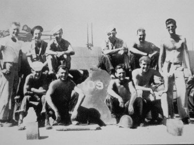 Lieutenant John F. Kennedy with the Crew of His Patrol Torpedo Boat PT-109, July 1943 Photographic Print