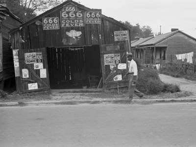 Advertisements for Popular Malaria Cure, Natchez, Mississippi, c.1935 Photo by Ben Shahn