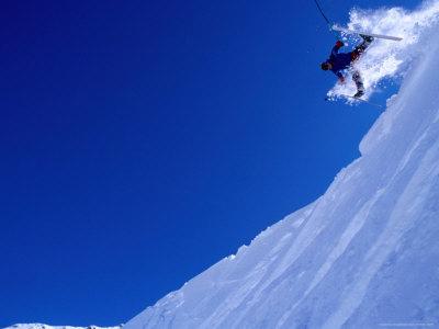 Skier Hurtling Over Cornice with Legs Apart, St. Anton Am Arlberg, Vorarlberg, Austria Lámina fotográfica por Christian Aslund
