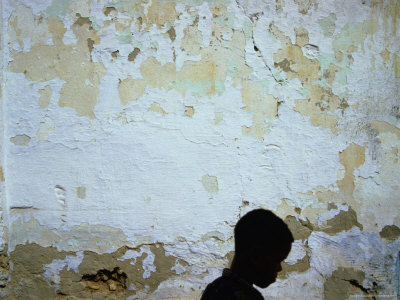 Boy Passing by Wall, Tozeur, Tunisia Photographic Print by Martin Lladó