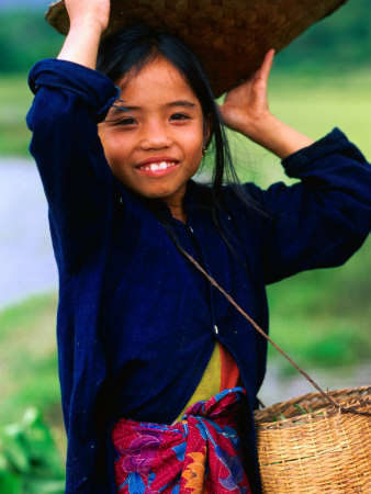 Portrait of Girl Balancing Basket of Herbs, Muang Ngoy, Laos Photographic Print by Anthony Plummer