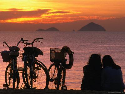 Couple at Beach at Sunrise, Nha Trang, Vietnam Photographic Print by John Banagan
