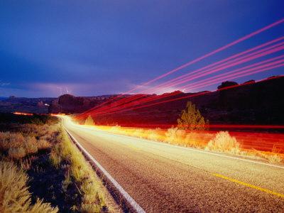 Vehicle Lights and Lightning Illuminating Road, Arches National Park, Utah, USA Lámina fotográfica por Gareth McCormack