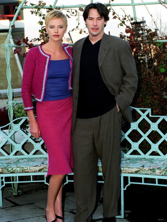 Keanu Reeves with Co-Star Charlize Theron at Photo Call for Film Devil's ...