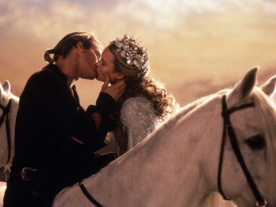 Buttercup and Westley Kissing on Horseback Photo