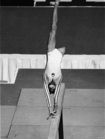 Olympic Games 1976: Romanian Gymnast Nadia Comaneci Competing in Montreal, Canada Photographic Print