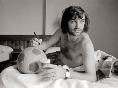 George Best Signing Football in His Hotel Room in Marabella, Spain, July 1972 Photographic Print