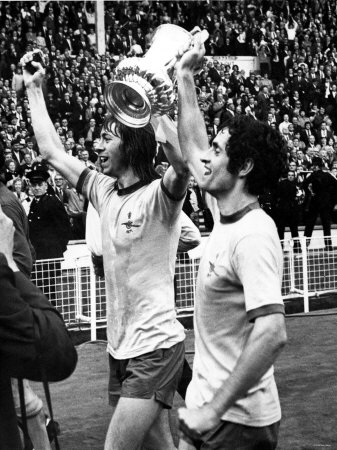Charlie George and Skipper Frank Mclintock Celebrate in Front of Fans After Defeating Liverpool Photographic Print