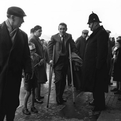 Brian Clough in March 1963, Sunderland's Injured Centreforward, Arrives to Watch the Game Photographic Print