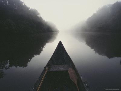 Canoe on Misty River Photographic Print by Mattias Klum
