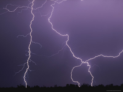 Dramatic Bolts of Lightning Crisscross a Night Sky Lmina fotogrfica