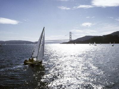 Boat Sails Toward the Golden Gate Bridge on San Francisco Bay Photographic Print by Rex Stucky