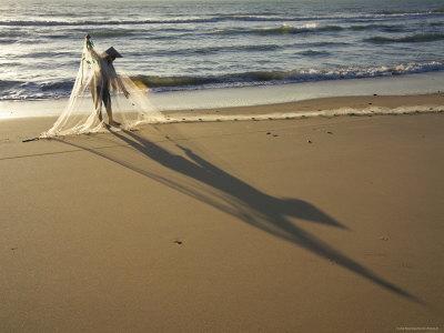 Woman Tending to Fishing Net on Beach Near Mui Ne Photographic Print by Dan Gair