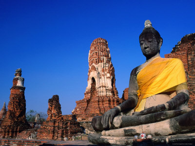 Buddha Statue in Yellow Silk with Ruins in Background Photographic Print by Paolo Cordelli