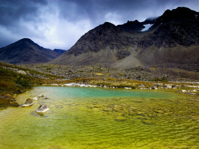 Colorful Lake Surrounded by Mountains in Stortinddalen, Lyngsalpene Photographic Print by Johnny Haglund