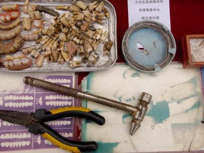 Local Dentist in Xizhou Market, Bai Village North of Dali, China Photographic Print by Pete Oxford