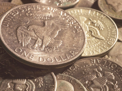 Close-Up of American Silver Dollar Coin with Eagle on its Face with Other Coins Photographic Print
