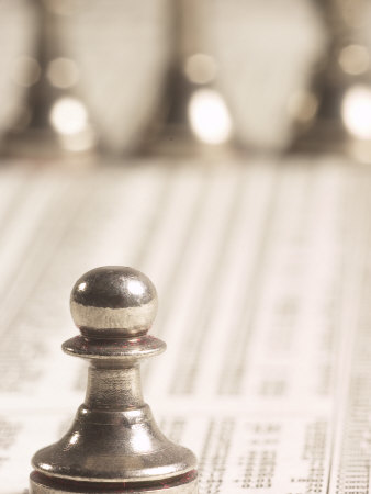 Selective Focus of Silver Pawn on Newspaper Stock Market Report with Line of Chess Pieces Photographic Print