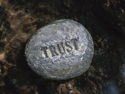 Stone with Word Trust in Water of Tranquil Stream Photographic Print