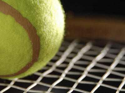 Close-Up of Tennis Ball on Webbing of Tennis Racket Photographic Print