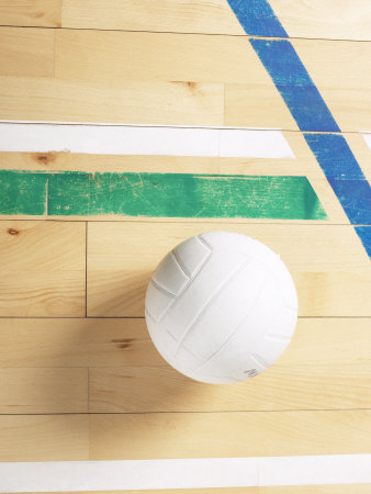 View of Volleyball on Wooden Gymnasium Floor Photographic Print