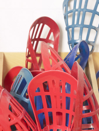 Red and Blue Lacrosse Sticks Inside Storage Bin Photographic Print
