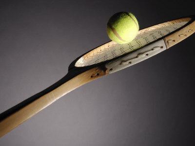 Studio Shot of Tennis Ball on Top of Tennis Racket Photographic Print