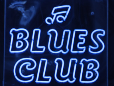 Neon Blues Club Sign Photographic Print