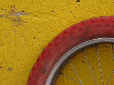 Cropped Red Bicycle Tire Photographic Print