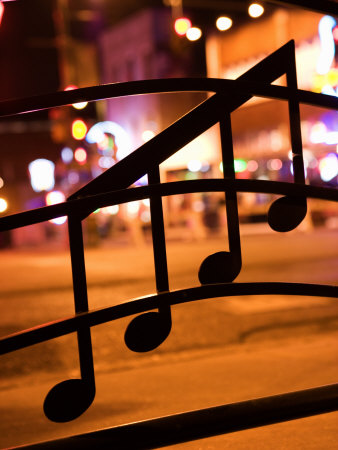 Nighttime View of Beale Street in Memphis, Tennessee Through Musical Notes on a Window Photographic Print