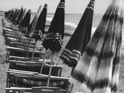 Beach Umbrellas and Lawn Chairs Closed on a Beach Photographic Print by Vincenzo Balocchi