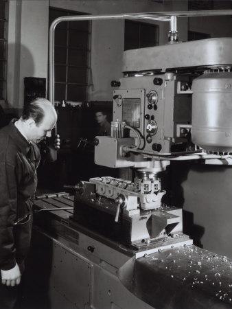 Ferrari Factory, Worker Operating a Machine Photographic Print by A. Villani