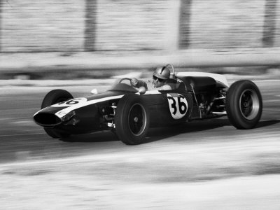 Pilot Driving a Racing Car in a Race Photographic Print by A. Villani