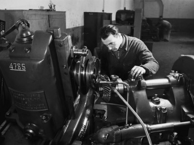 Worker at Work in the S.A.M.P. Mechanical Factory in Bologna, Producer of Precision Mechanisms Photographic Print by A. Villani