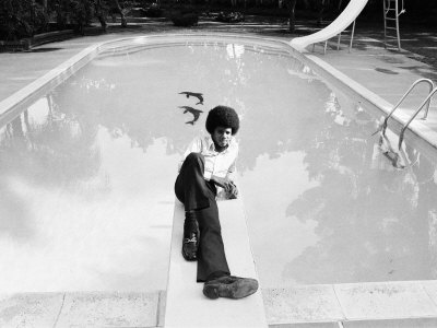 Michael Jackson at Home in Los Angeles by the Poolside, Lounging on Diving Board, February 23, 1973 Photographie