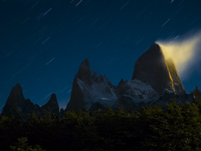 The moon illuminates clouds on Mount Fitz Roy Photographic Print by Jordi Busque